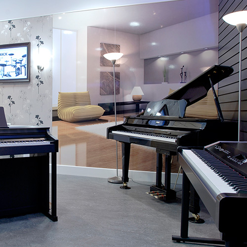 Trying out a piano in a music shop - Digital Piano Buyers Guide | Roland UK
